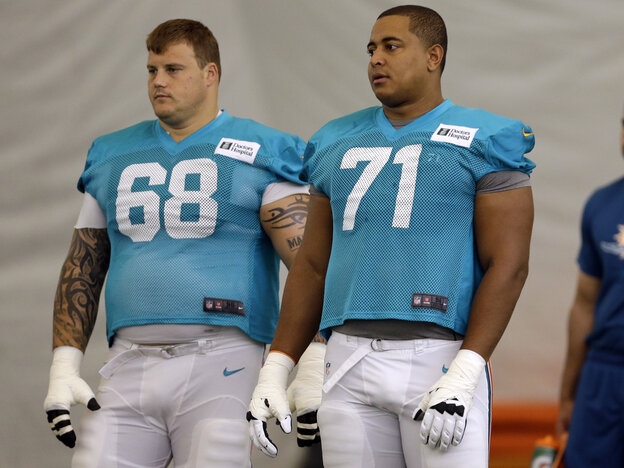Miami Dolphins offensive linemen Richie Incognito, left, and Jonathan Martin in July.
