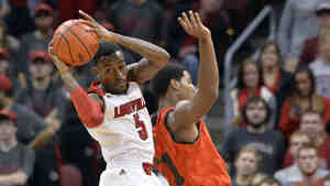 Louisville's Kevin Ware, in the white uniform, was back in action Wednesday night. He returned to the court for the first time since breaking his leg last spring.