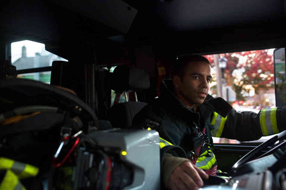 Probationary firefighter and military veteran Victor Ramos gets truck driving practice n