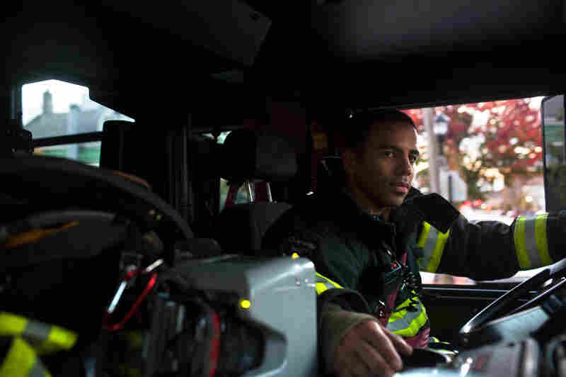 Probationary firefighter and military veteran Victor Ramos gets truck driving practice near the 16th Street Firehouse in Union City, N.J. New Jersey's North Hudson Fire Department hired 43 veterans this year.
