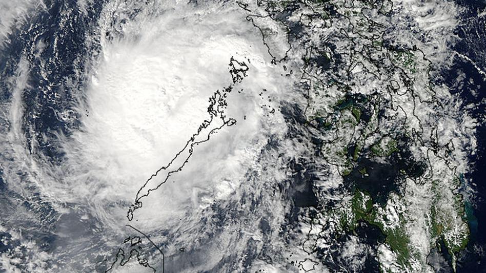 Typhoon Bhopa scene over the Philippine island of Palawan last December. (NASA Goddard's MODIS Rapid Response Team)