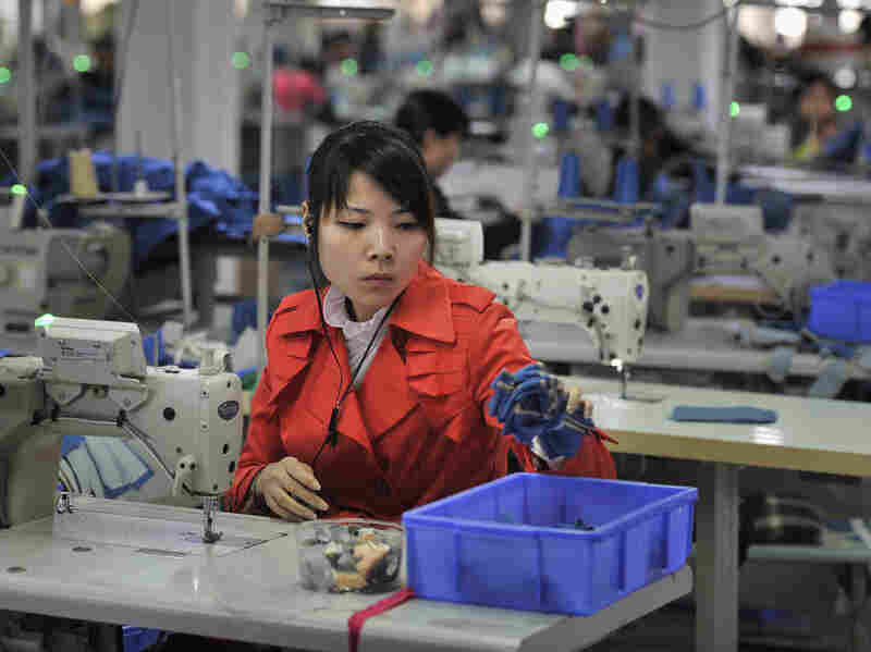 An employee works inside a factory manufacturing clothes for export, in Wuhu, Anhui province, on Nov. 5.
