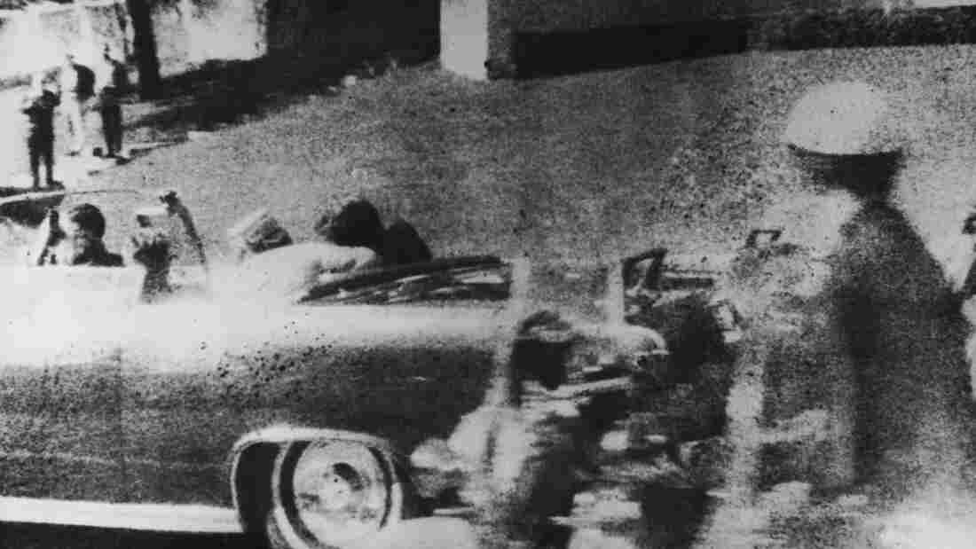 The president is struck by a bullet as he travels through Dallas in a motorcade Nov. 22, 1963. Next to him in the car is his wife, Jacqueline, and in the front seat is Texas Gov. John Connally.