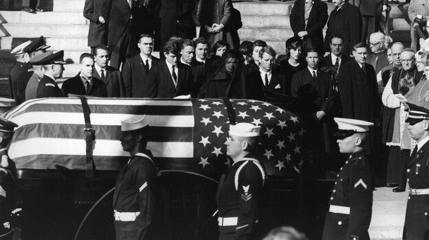 Jacqueline Kennedy (center), with Edward and Robert Kennedy on either side, watches the coffin of President John F. Kennedy pass on Nov. 25, 1963.