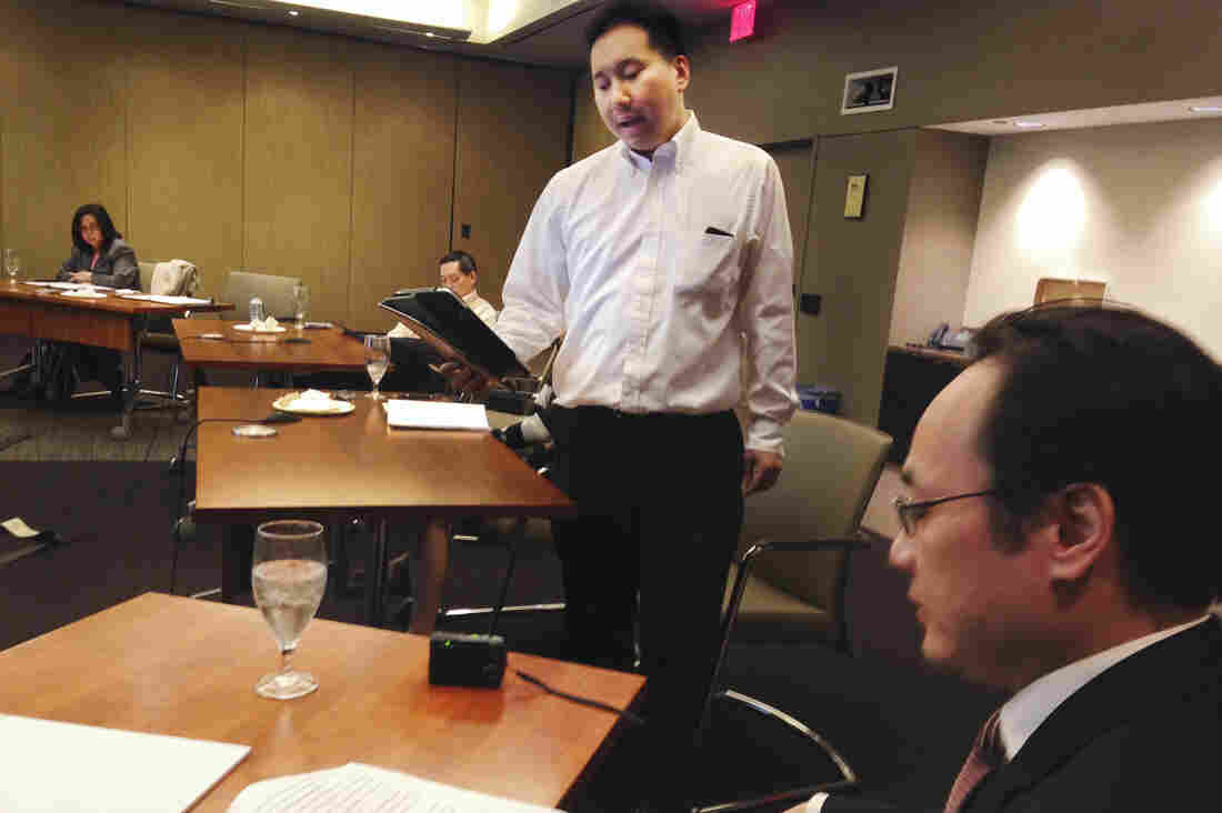 Attorney Francis Chin (center) runs through his lines with Yang Chen at a rehearsal for 22 Lewd Chinese Women, the latest trial re-enactment by the Asian American Bar Association of New York.