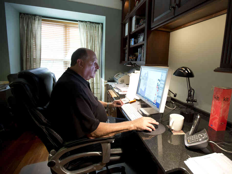 Graphic designer Tom Sadowski, 65, works from home in Sterling, Va., in October. Many experts believe the economy is becoming too complicated for the Bureau of Labor Statistics to measure accurately using current m