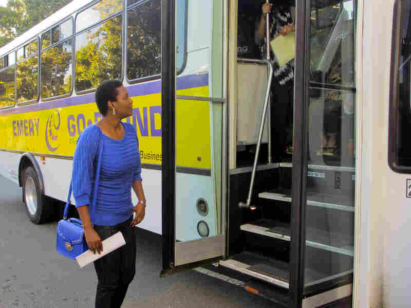 """There were 1.5 million boardings on the Emery Go Round last year. Zikhona Tetana, a visiting scientist from South Africa, is taking the Emery Go Round to a Lawrence Berkeley National Laboratory facility in Emeryville. """"It's convenient and always on time,"""" she says."""