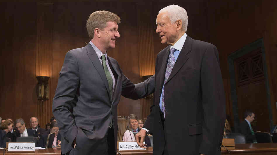 Former Rep. Patrick Kennedy (left) is welcomed by Sen. Orrin Hatch, R-Utah, during a hearing about mental health parity rules Thursday. A new rule issued by the Obama administration aims to increase parity for how insurers handle