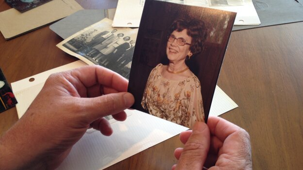 Jim Fossum holds a photograph of his aunt, Elsie Fossum, who died from injuries her caregiver said were the result of a fall.
