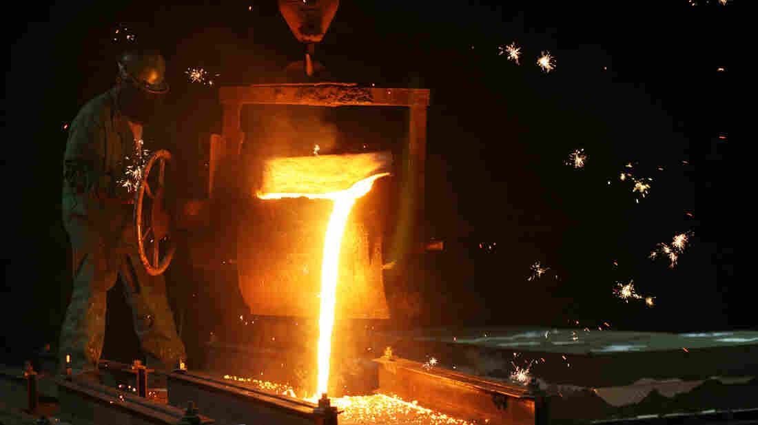 Sparks fly as Dan Hensley pours liquid iron (at 2575 degrees Farenheit) into the mold for a piano plate destined for Steinway pianos, at O.S. Kelly foundry in Springfield, Ohio.