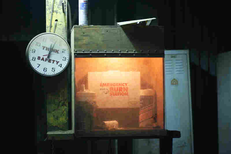 A safety station at the foundry is covered in a layer of dust from the furnace. Safety is a top priority since a small drop of molten metal can cause serious burns.