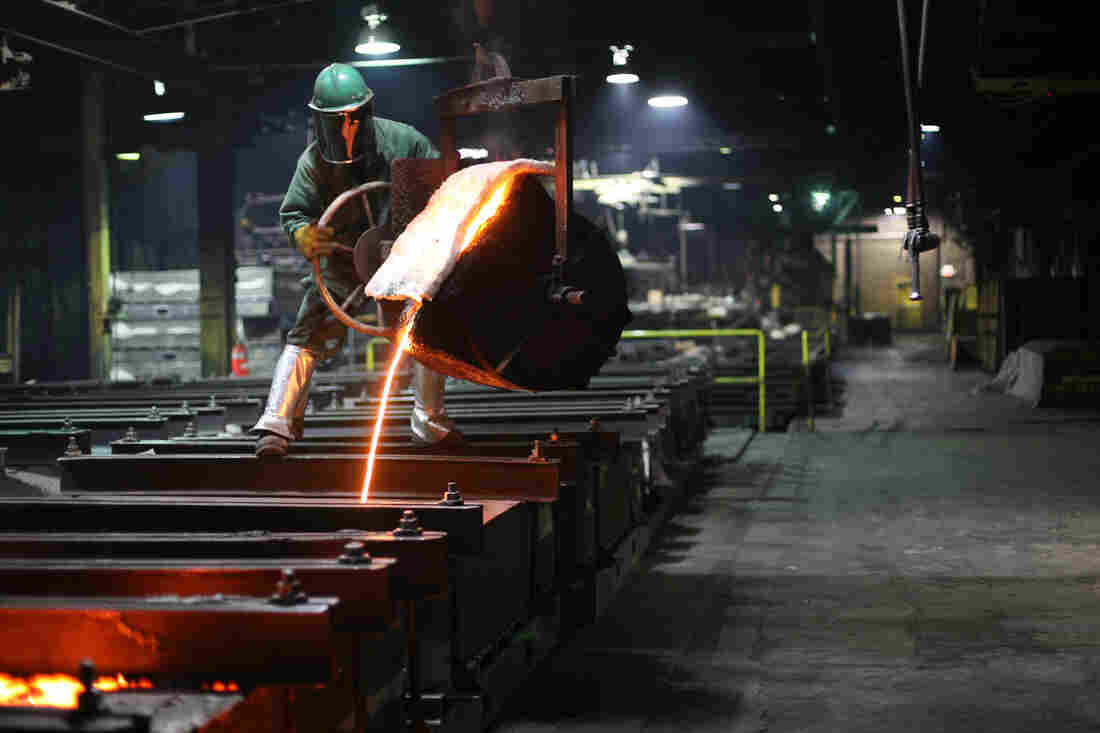 Houseman pours molten iron for the plates. The foundry creates 4,000 cast iron piano plates a year.