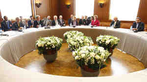 Negotiators at their round table in Geneva, where talks are being held about Iran's nuclear ambitions.