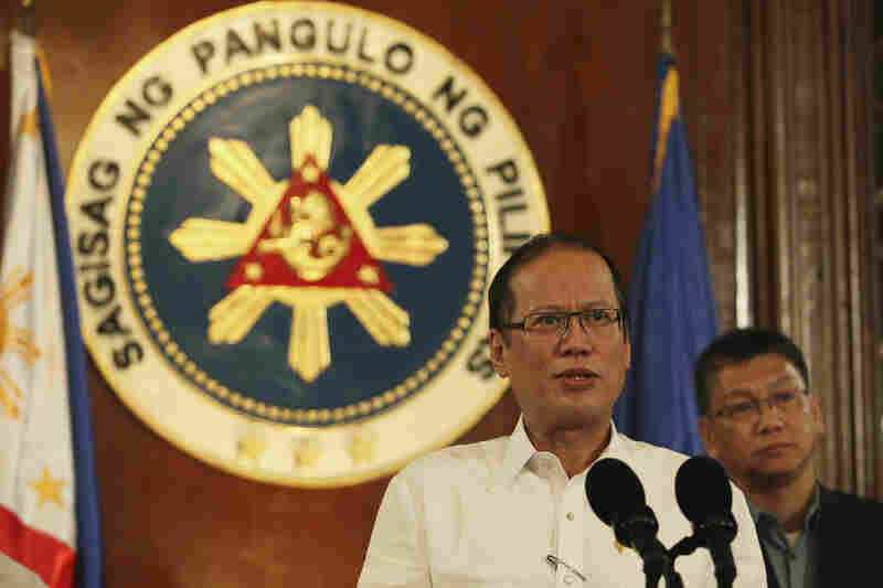 Philippine President Benigno Aquino III, with Executive Secretary Paquito Ochoa Jr., speaks about the storm during a nationally televised address at the Malacanang Palace in Manila.