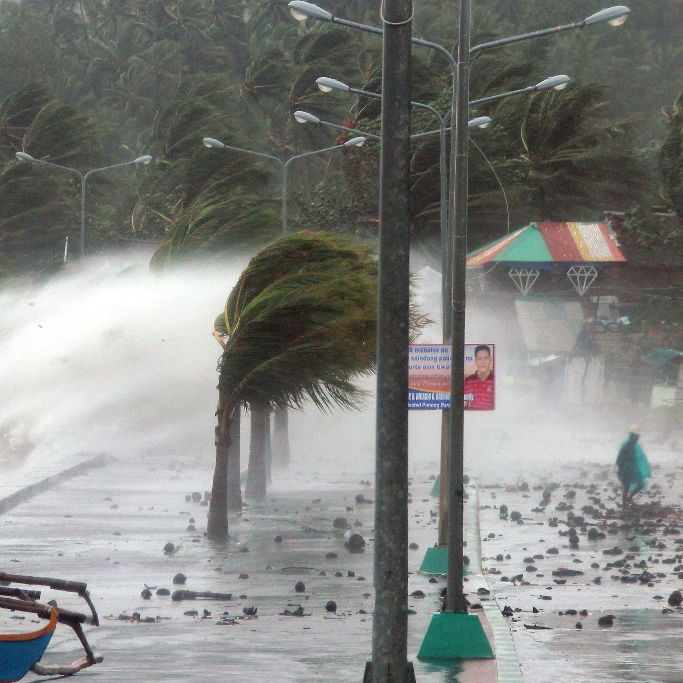 On the ground, Typhoon Haiyan's fury was easy to see. Here's how things looked in the city of Legaspi, Albay province, on Friday.