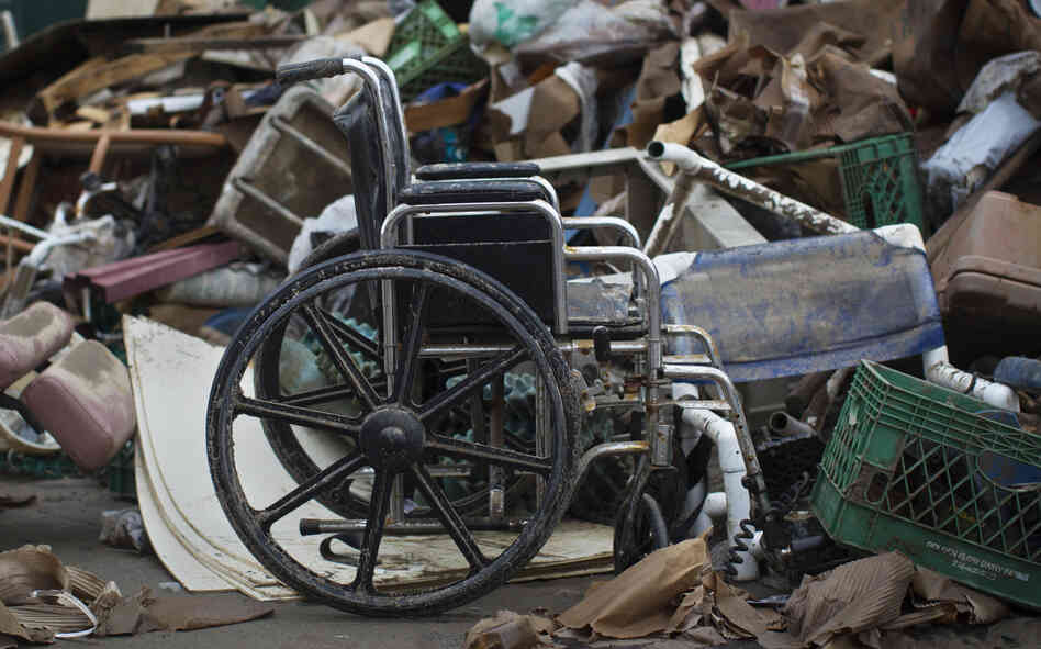 A wheelchair is among debris from Superstorm Sandy in the Queens borough of New York on Nov. 13, 2012. A judge ruled Thursday that the city does not have adequate plans for evacuating people with disabilities.