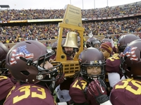 Minnesota Players carry an intact Governor's Victory Bell trophy after defeating Penn State 24-10 in an NCAA college football game in Minneapolis on Saturday.
