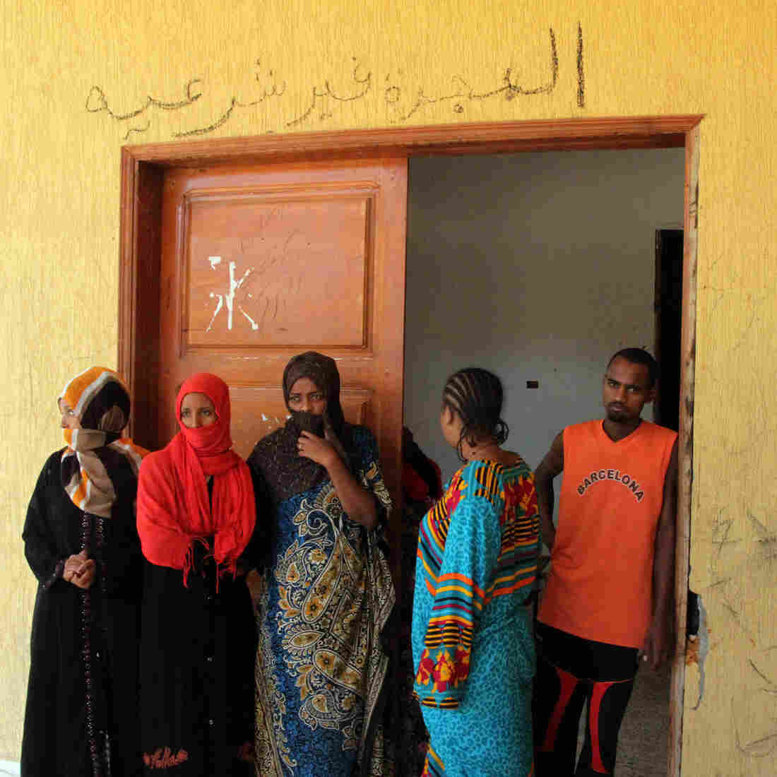 Illegal immigrants captured in the Libyan coastal city of Surman are held at a temporary prison in an eastern district of Tripoli, Libya, on Oct. 19.