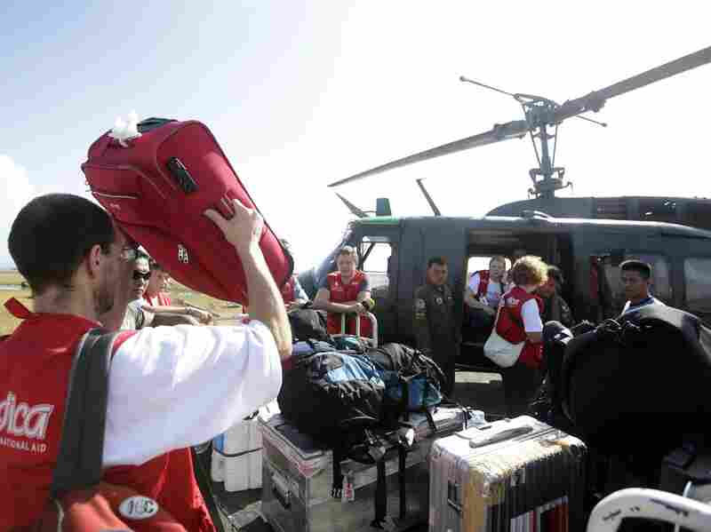 A German medical team prepares to board a military helicopter in the devastated city of Tacloban on Monday.