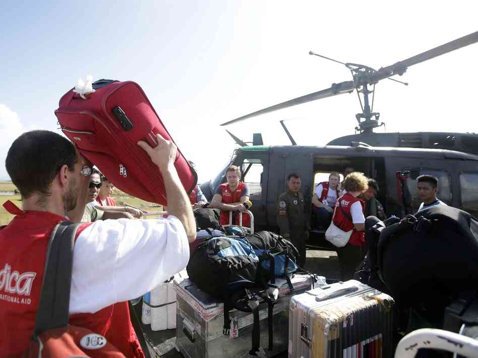 A German medical team prepares to board a military helicopter in the devastated city of Tacloban, Philippines, on Nov. 11.