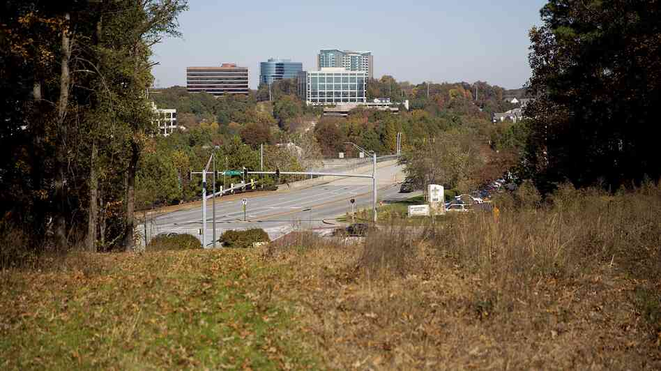 Undeveloped land stands in the area where a new stadium will be built for the Atlanta Braves. Monday, the te