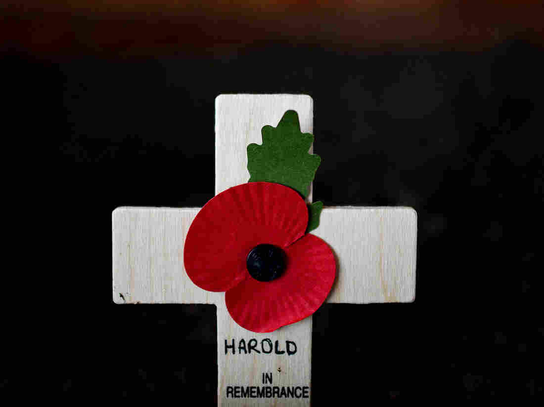 A cross adorned with a poppy was among the ways Harold Percival was remembered Monday. Poppies have been a symbol of remembrance for veterans since the poem In Flanders Fields was written in 1915 by a Canadian military doctor.