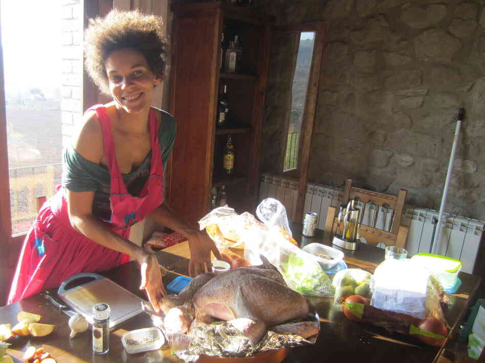 Janine Denny of New York readies the Thanksgiving table in Spain