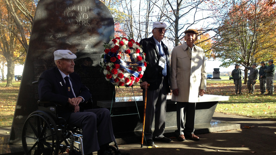 Staff Sgt. David J. Thatcher (left), Lt. Col. Edward Saylor (center) and Lt. Col. Richard Cole (right) stand at the Doolittle Raider Monument at Memorial Park in Dayton, Ohio.
