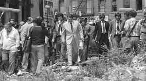 Ronald Reagan walks over rubble in a South Bronx lot in August 1980.