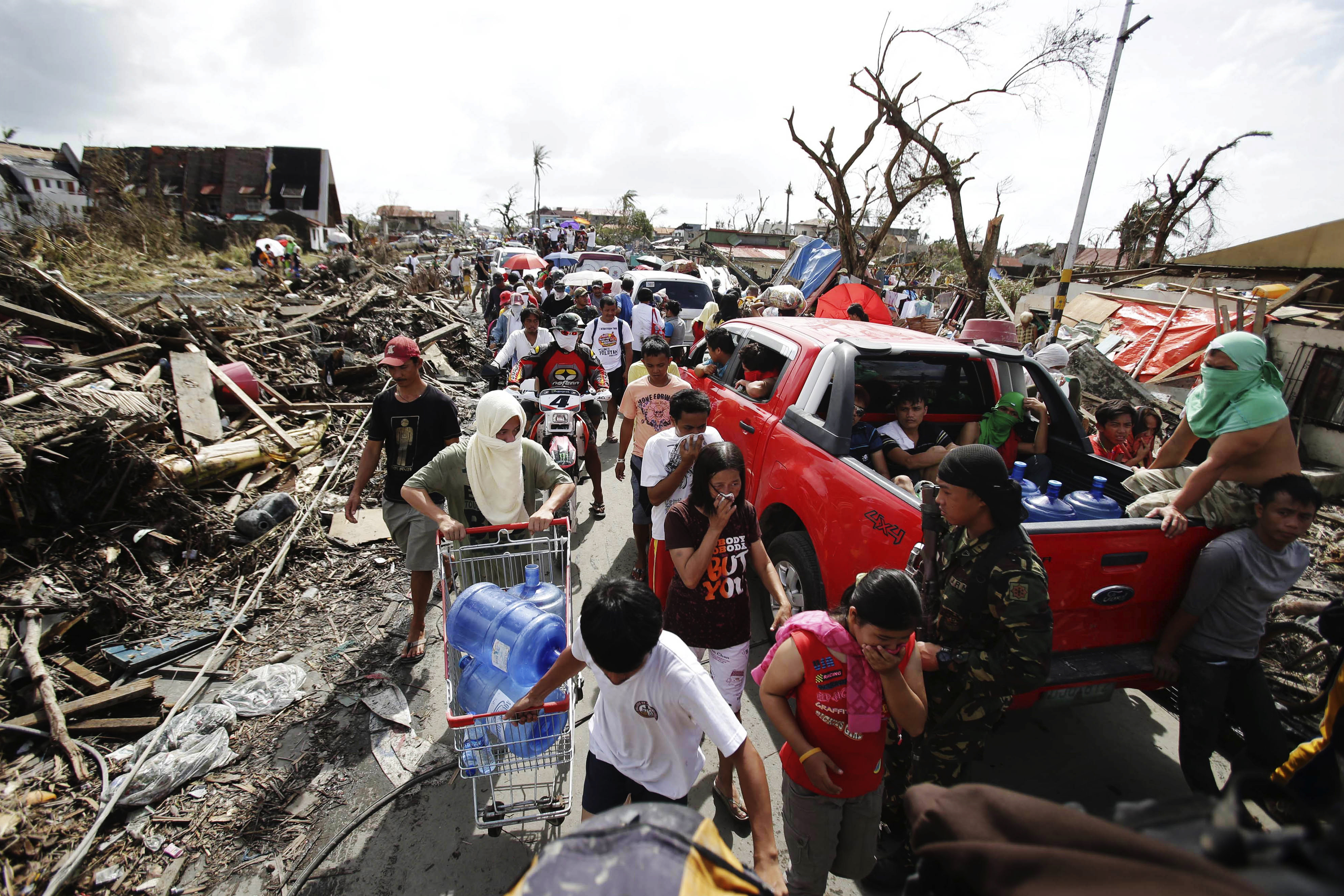Typhoon survivors fill the streets as they race for supplies in Tacloban. The city was flattened by the huge storm, authorities say.