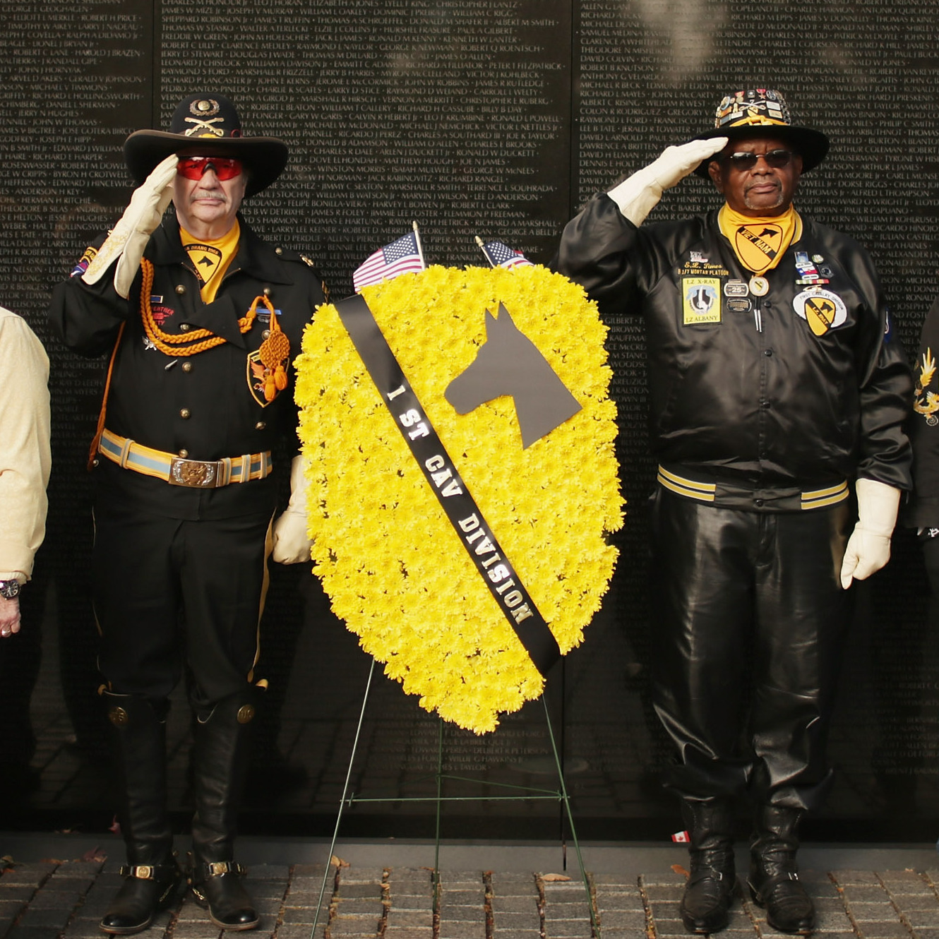 "Veterans of the Vietnam War place wreaths at ""The Wall"" during a Veterans Day event at the Vietnam Veterans Memorial on the National Mall Monday."