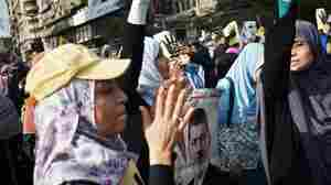 Women supporters of the Muslim Brotherhood and ousted president Mohamed Morsi take part in a march through the streets of Cairo on November 8, 2013.