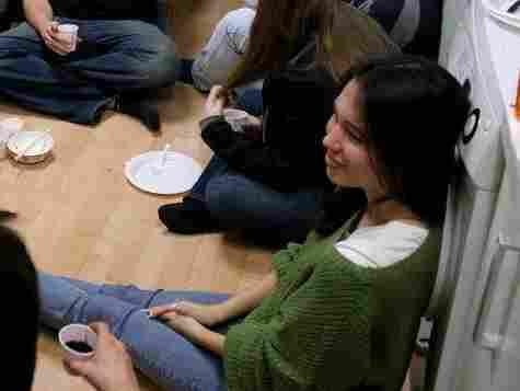 Jessica Osborne, in green sweater, celebrates Thanksgiving with friends in Seoul.