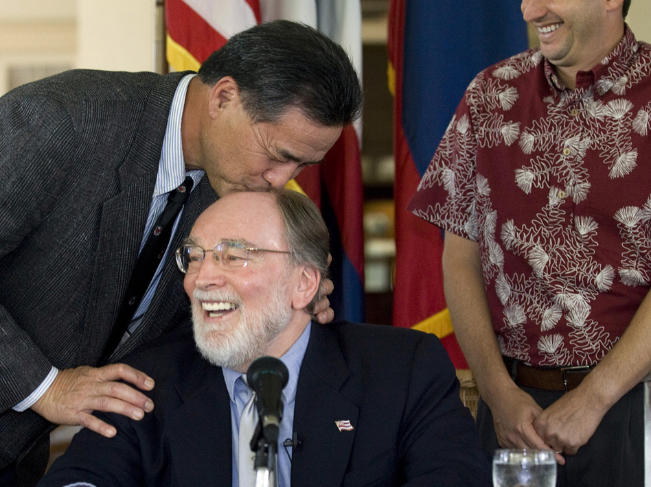 Hawaii state Sen. Clayton Hee playfully gives Gov. Neil Abercrombie a kiss on the head before he signs the Hawaii Civil Unions bill into law at a ceremony in February 2011 in Honolulu.