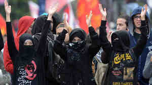 A new survey of gender experts finds that in the Arab world, Egyptian women face the worst treatment. Here, women attend a political march to the presidential palace in Cairo in February.