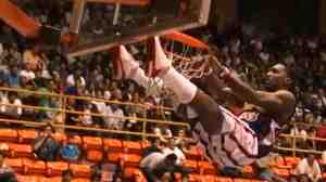 "Uh-oh. William ""Bull"" Bullard of the Harlem Globetrotters brought the basket, backboard and stanchion down with him after a dunk. He just missed getting crushed."