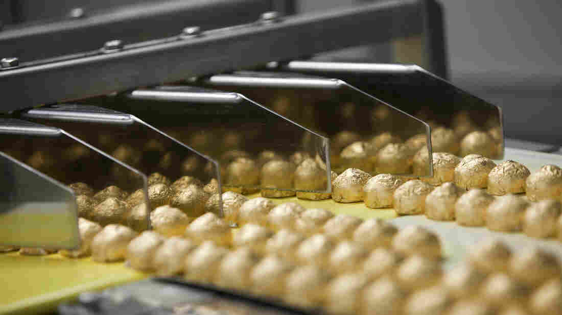 Individually wrapped chocolate-covered hazelnut sweets move along a conveyor belt on the production line at the Roshen Confectionary Corp. factory in Kiev, Ukraine. A Russian ban on Ukraine's chocolate comes at a time when the nation is considering aligning itself with the European Union.