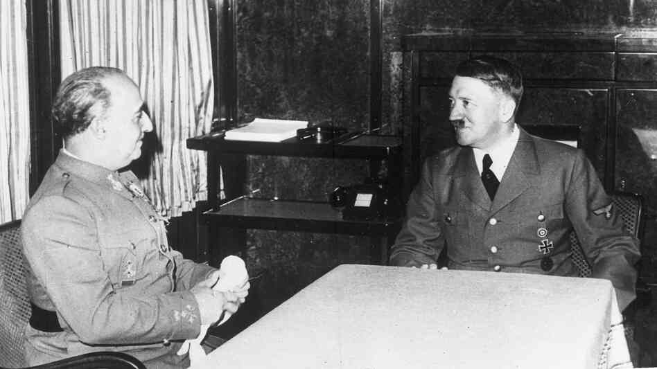 German Chancellor Adolf Hitler, talks with Spain's Generalissimo Francisco Franco, in Hendaye, France, October 23, 1940, in Hitler's railway carriage. Later, Franco moved Spain's clocks ahead an hour to be aligned with Nazi Germany.