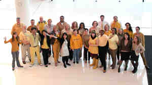 NPR staffers dressed in gold in celebration of the Headquarters earning LE