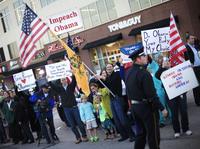People protest President Obama's