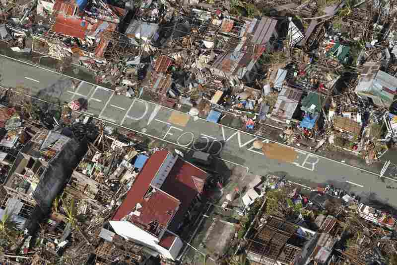 An aerial view shows signs pleading for help and food in the coastal town of Tanawan, central Philippines. When Haiyan made landfall on Friday, it was packing winds that sometimes reached or exceeded 200 mph.