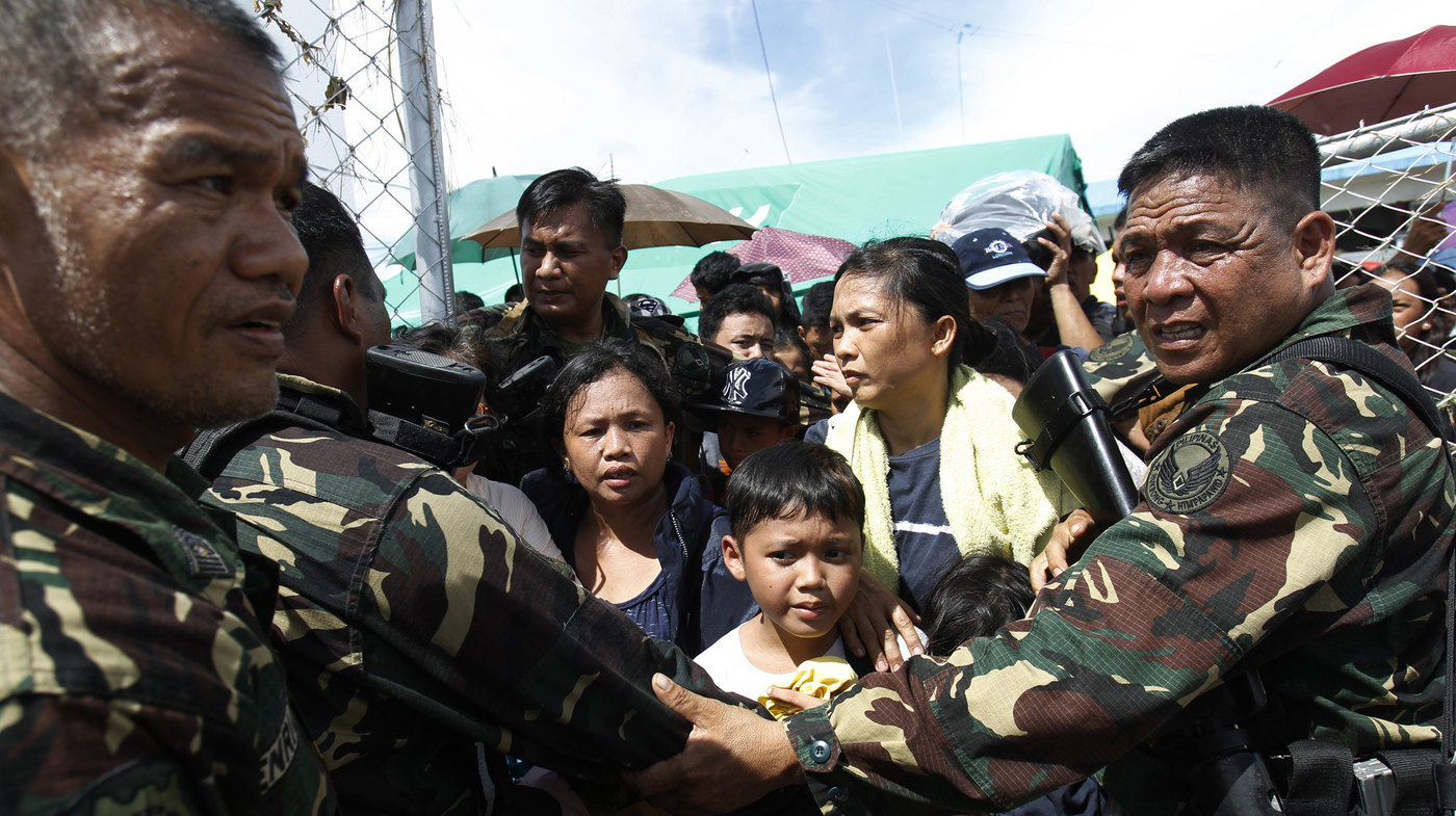 Typhoon Victims Struggle To Survive As Aid Is Slow To Arrive