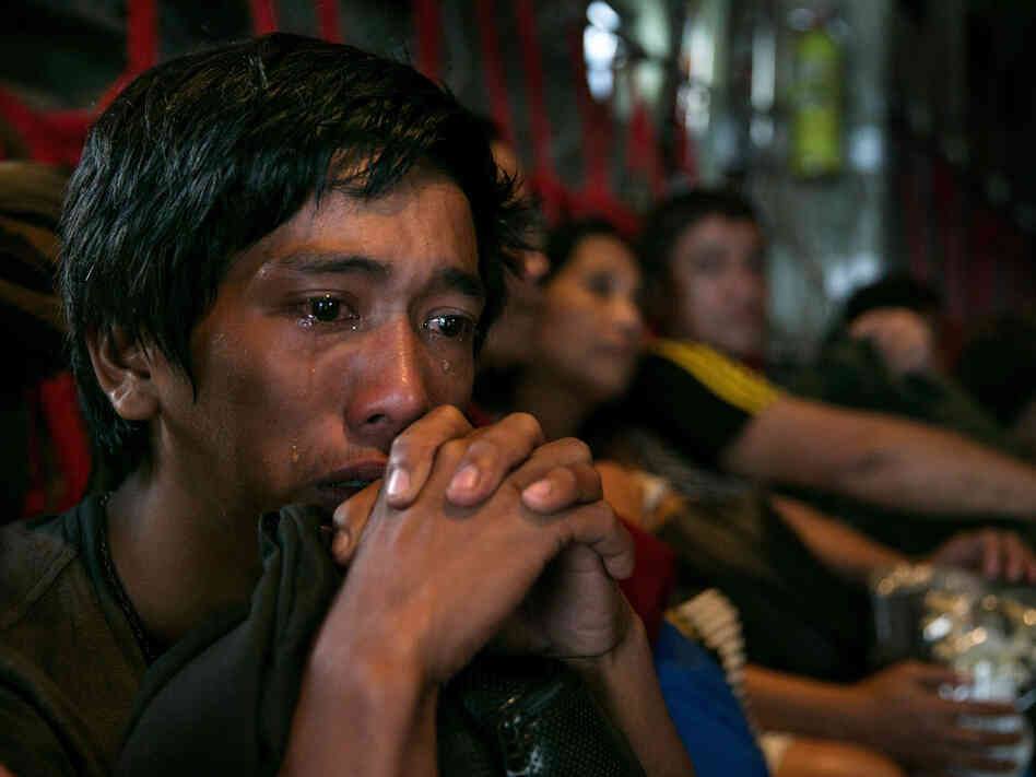 In anguish: Tears ran down the cheeks of a man as he waited with other survivors Tuesday for a flight out of Tacloban in the Philippines, which was devastated by Typhoon Haiyan.