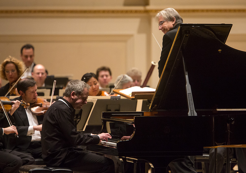 "Jeremy Denk joined the orchestra for Mozart's Piano Concerto No. 25, a piece which the pianist calls ""outrageously beautiful"" in its shadings of light and dark."