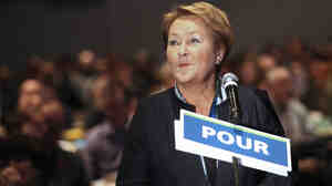 Quebec Premier Pauline Marois stands to support a motion regarding the controversial values charter at the Parti Quebecois Convention in Montreal on Sunday.