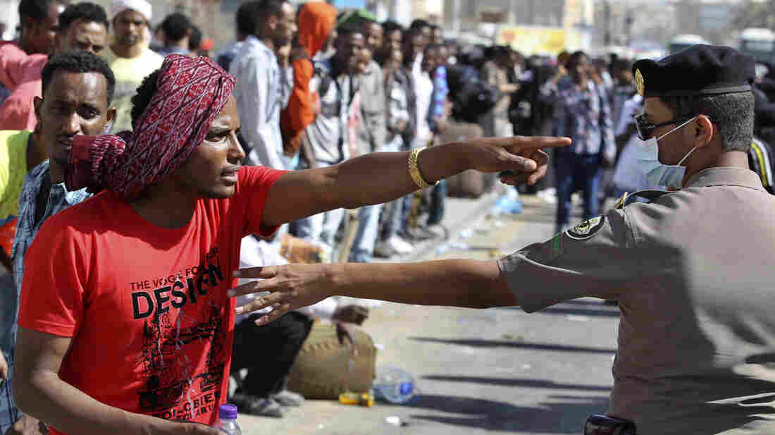 An Ethiopian worker argues with a member of the Saudi security forces as he waits with his countrymen to be repatriated in Riyadh on Monday.