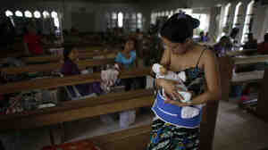 A mother breastfeeds her baby inside a chapel tha