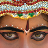 An Indian schoolgirl dressed as Telugu Talli poses for the camera during a celebration in Hyderabad, home to a study that seems to show the onset of dementia is delayed for people who speak more than one language.