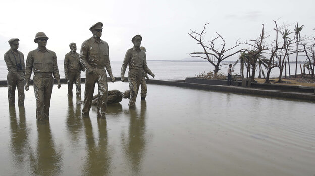 These statues depict the historic return of U.S. Gen. Douglas MacArthur (in front) to Tacloban, the Philippines, during World War II. The typhoon last week toppled one of the statues of a Filipino official, as shown in this photo taken Tuesday.