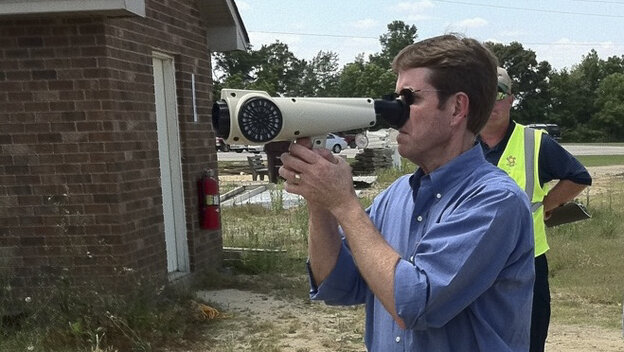A man uses the Nasal Ranger to detect smells in the